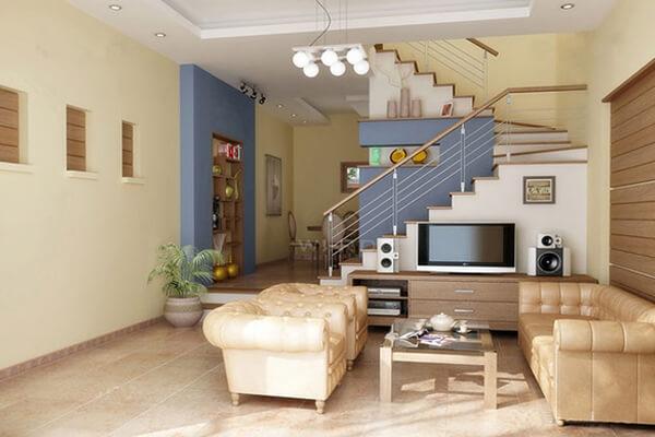 Phòng khách được bài trí đơn giản kết hợp với cầu thang